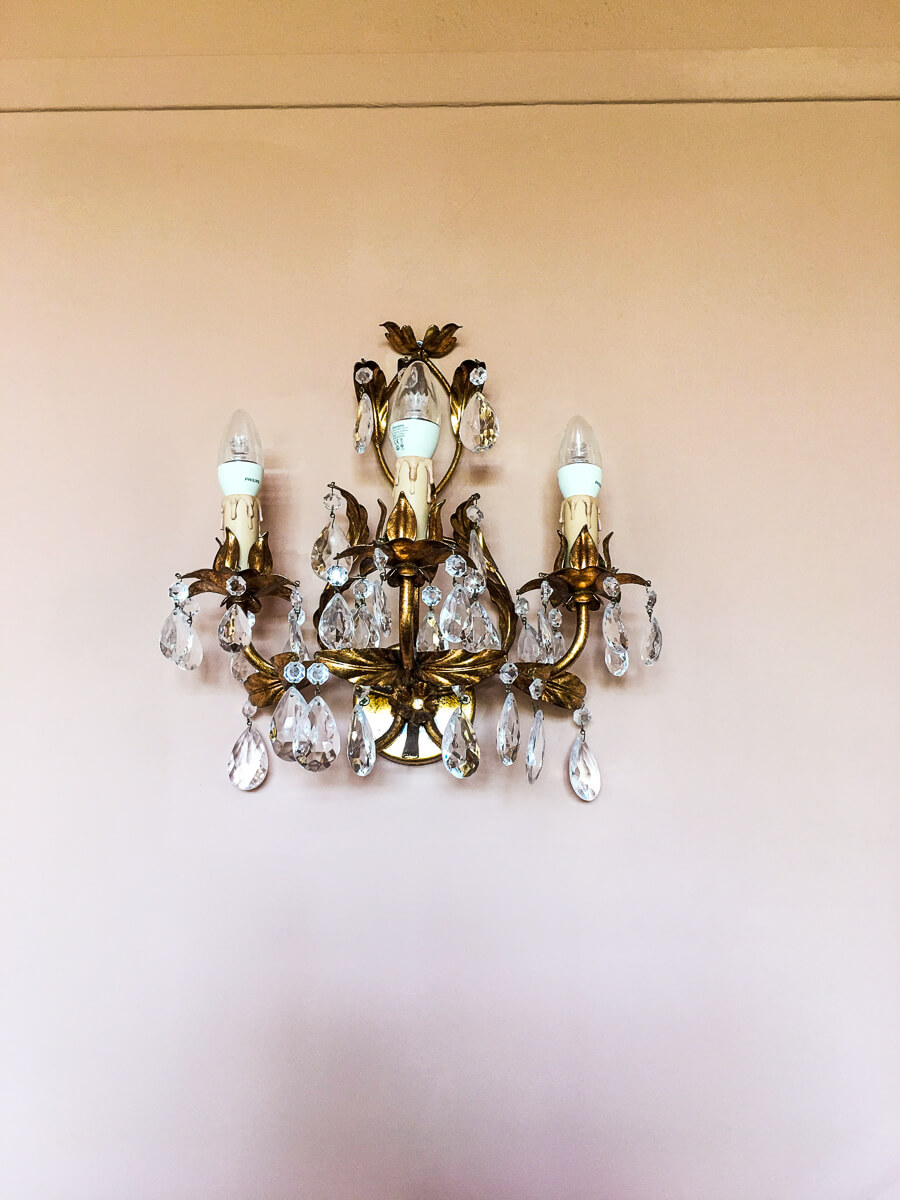 Gorgeous antique brass chandelier in our room