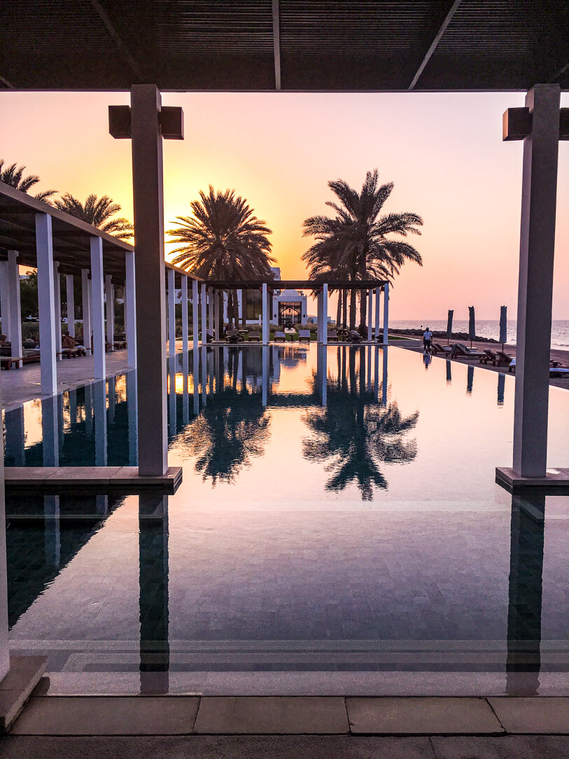 The Chedi pool at sunset
