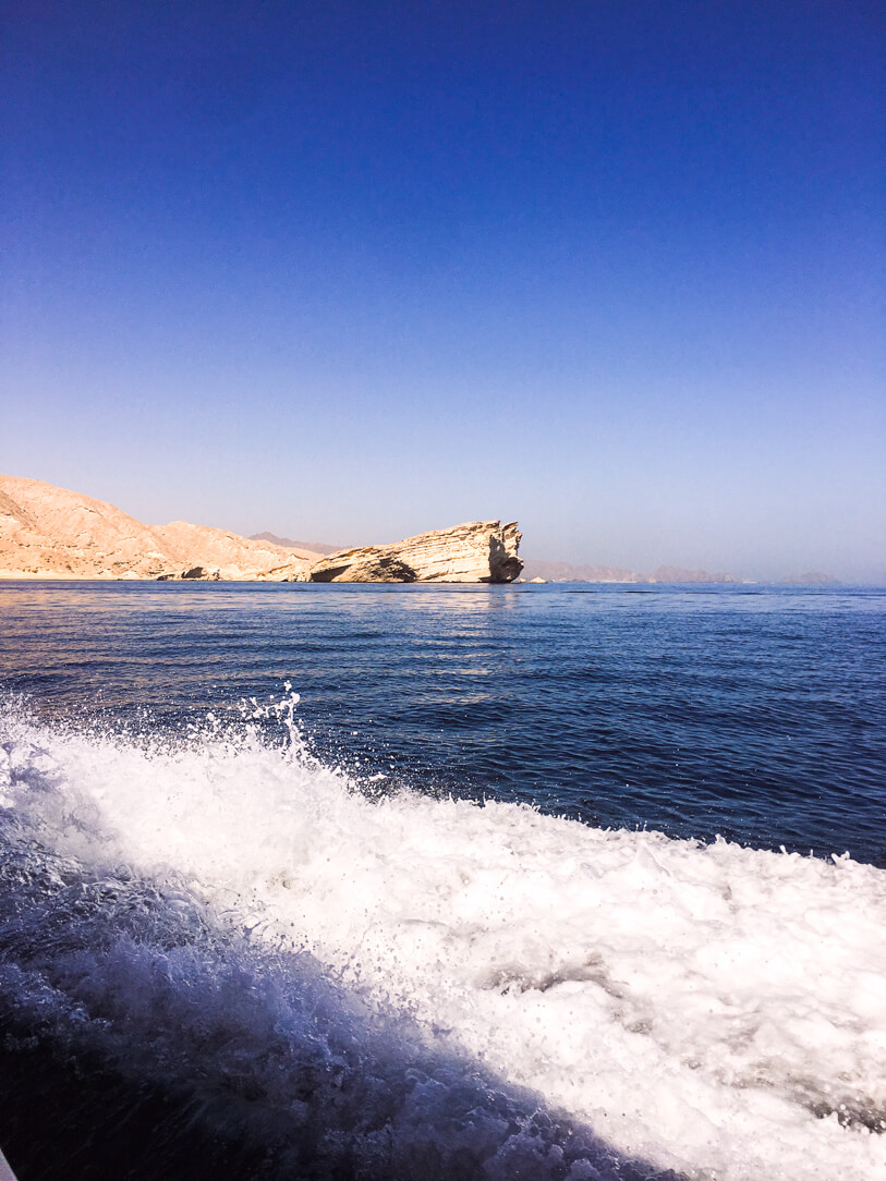 Top Things to Do In Muscat Oman: view of the shoreline on our dolphin watching tour