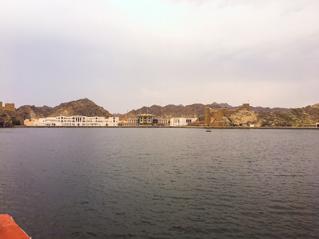 Top Things to Do In Muscat Oman: view of the shoreline on our the dhow tour
