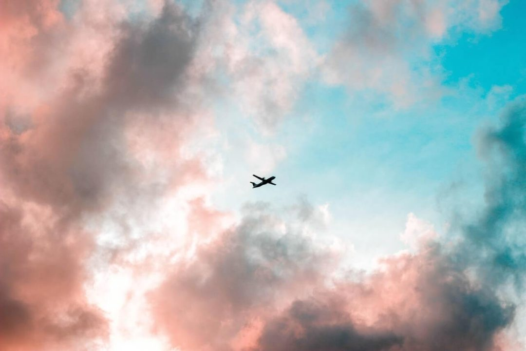 Plane flying into the sunset