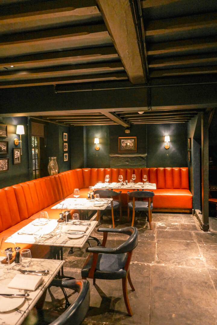 Cozy decor at the Lygon Bar & Grill at the Lygon Arms, a boutique luxury hotel in Broadway in the Cotswolds