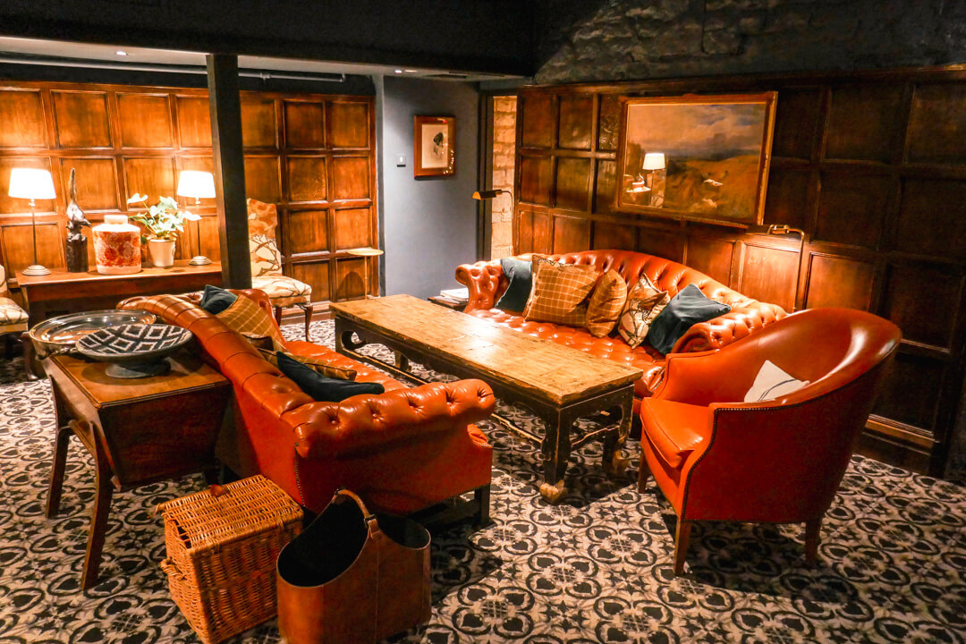 One of the Lygon Lounges at the Lygon Arms, a boutique luxury hotel in Broadway in the Cotswolds