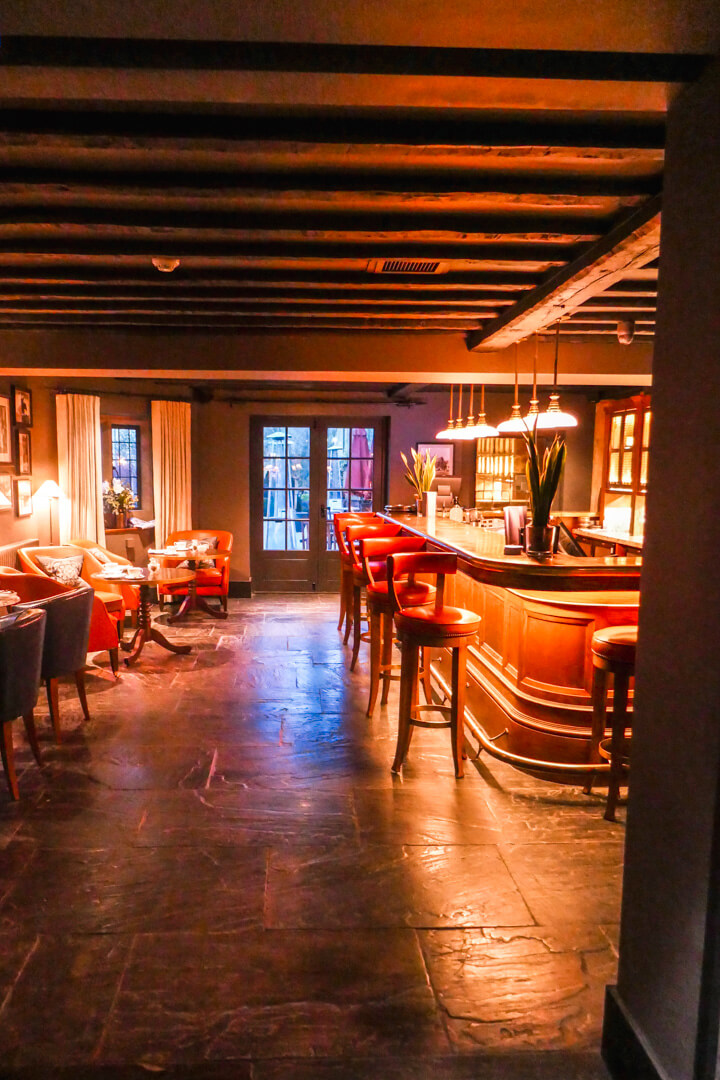 The bar at the Lygon Arms, a boutique luxury hotel in the village of Broadway in the Cotswolds