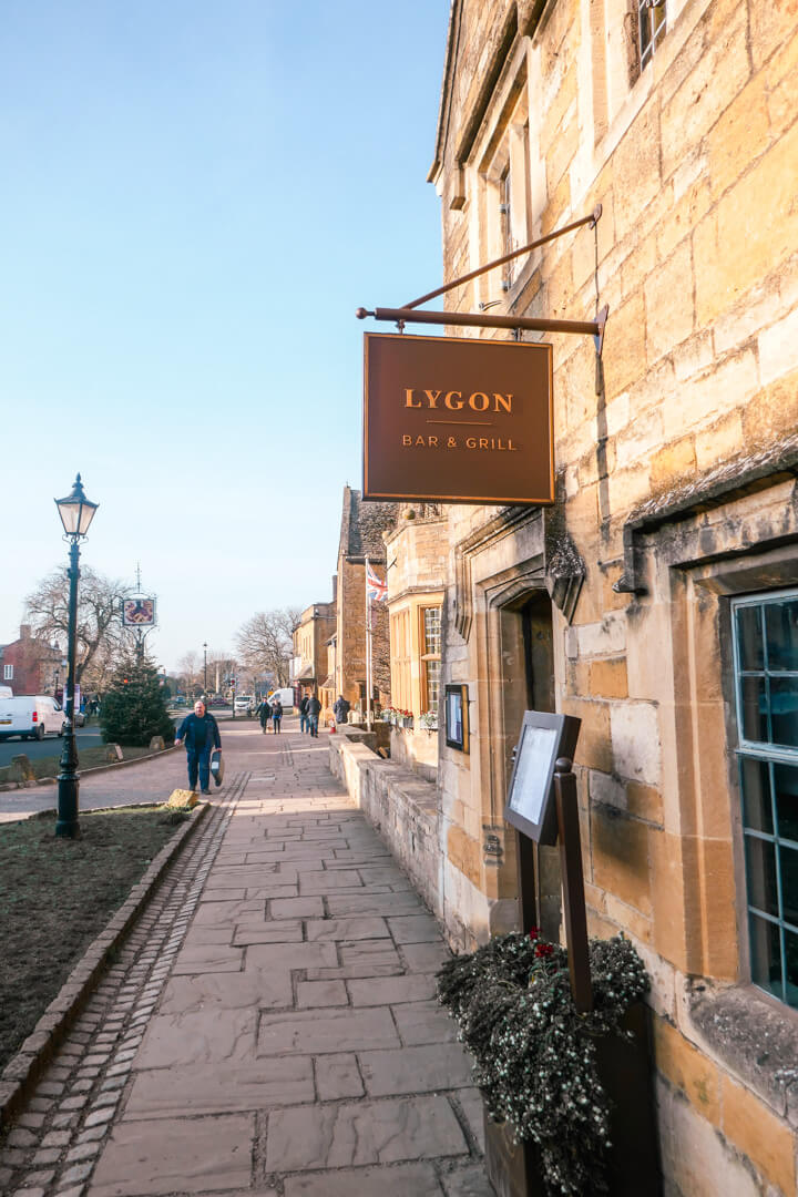 Entrance to the Lygon Bar & Grill at the Lygon Arms, a boutique luxury hotel in the village of Broadway in the Cotswolds