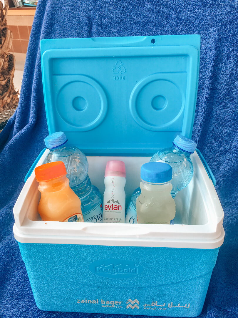 The complimentary ice box with drinks and Evian face spray