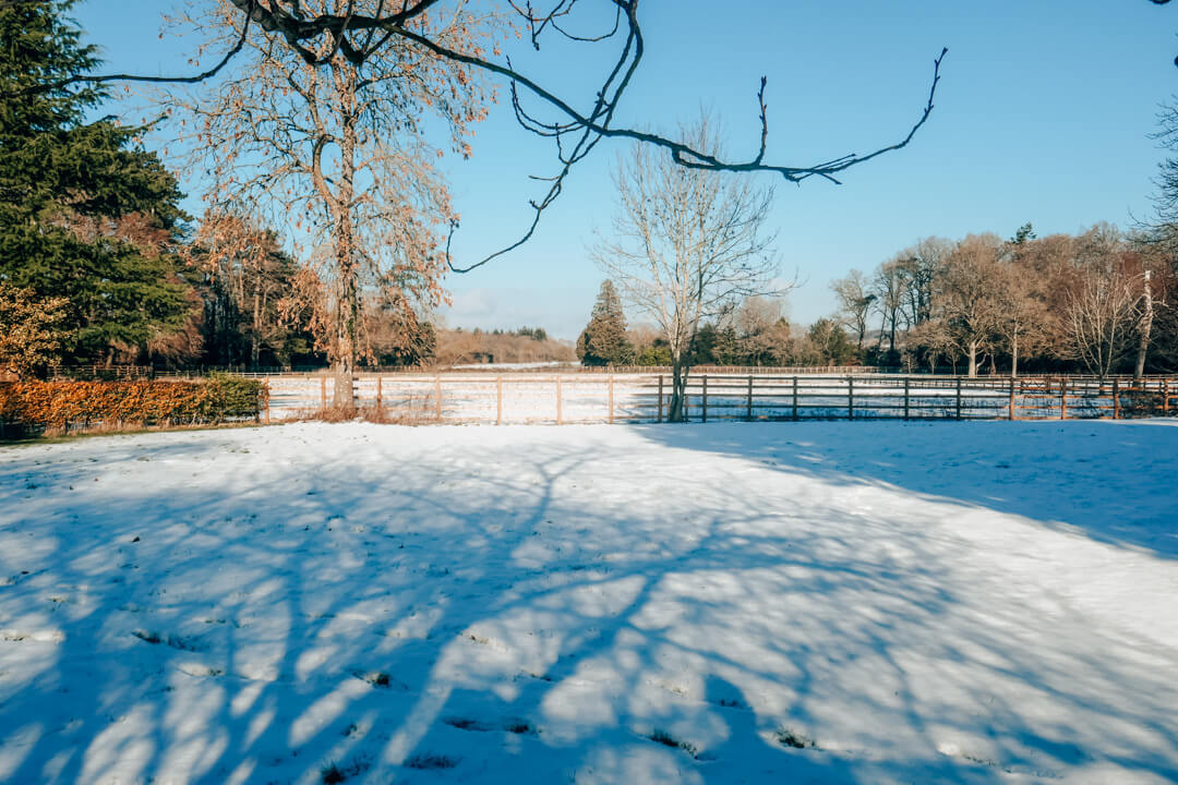 Gardens in the snow at Slaughters Manor House, a luxury boutique hotel in the Cotswolds