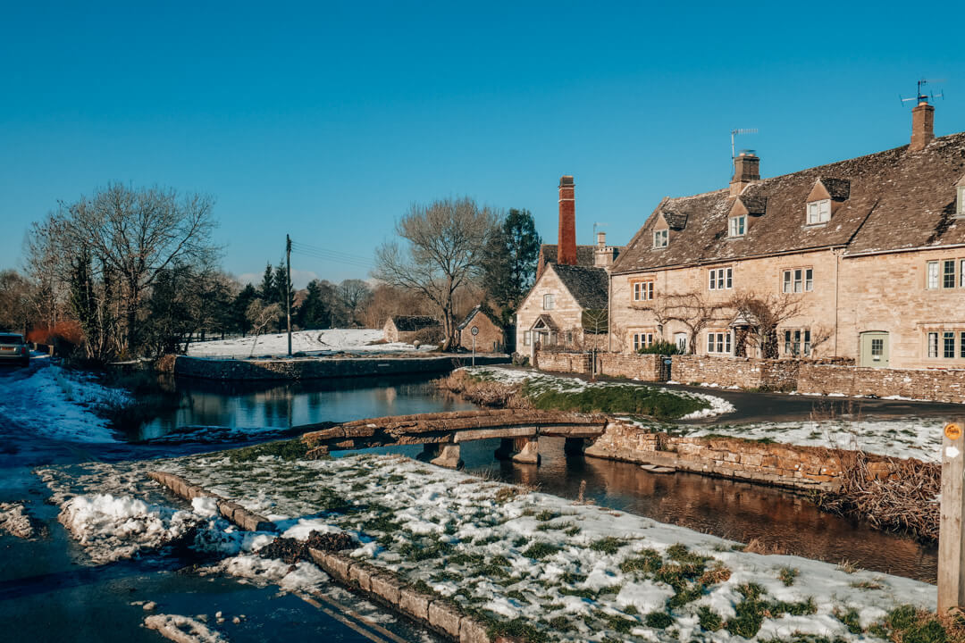 Old Mill Museum & the River Eye in a snowy Lower Slaughter