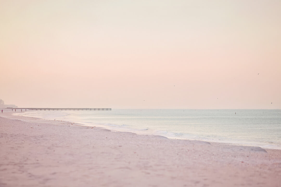 The future of travel post quarantine, an empty beach at sunset