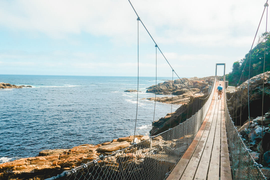 Crossing the suspension bridges at Storms River Mouth at Tsitsikamma National Park